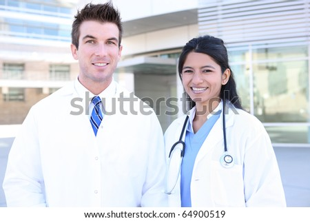 Handsome man doctor and woman nurse outside hospital - stock photo
