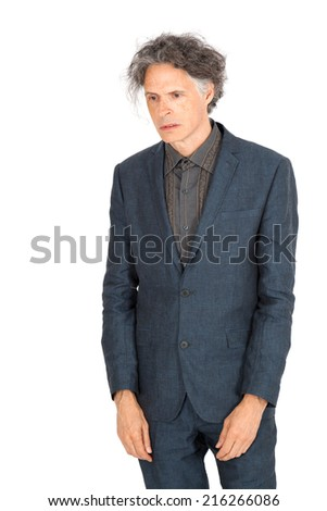 Handsome man doing different expressions in different sets of clothes: sadness - stock photo
