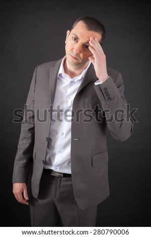 Handsome man doing different expressions in different sets of clothes: worried - stock photo