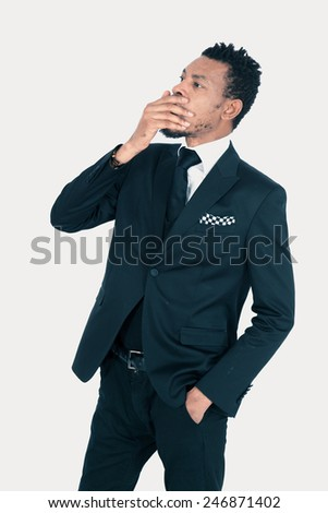 Handsome man doing different expressions in different sets of clothes: yawning - stock photo