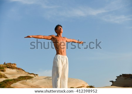 handsome man doing yoga exercise in outdoors