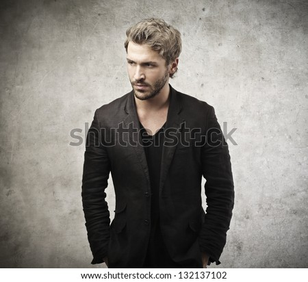 handsome man dressed in black jacket - stock photo