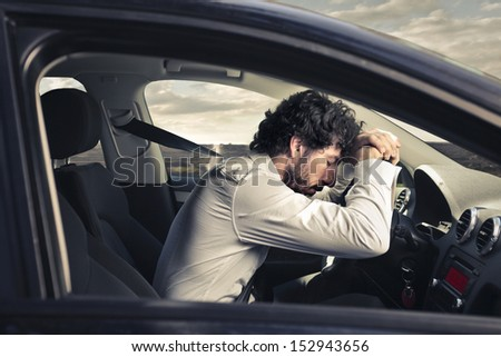 handsome man driving a sports car - stock photo