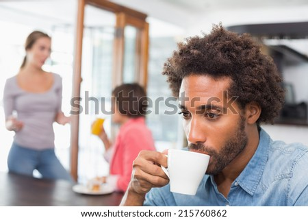 Handsome man enjoying his coffee at the coffee shop - stock photo