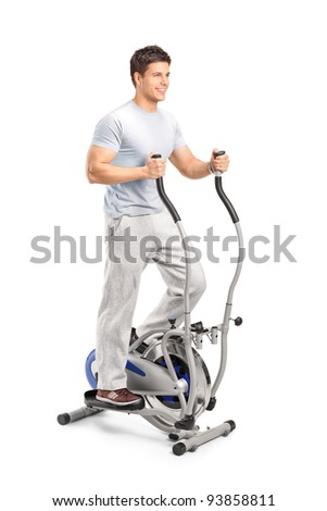 Handsome man exercising on a cross trainer machine, isolated on white - stock photo