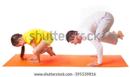 Handsome man father dad practicing yoga with his cute adorable beautiful daughter isolated on white background
