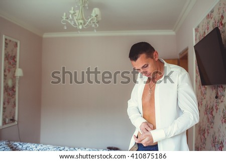 handsome man groom at home - stock photo