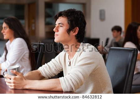 Handsome man having a coffee in a cafe - stock photo