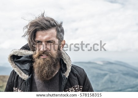 Handsome man hipster guy beard moustache stock photo 578158315 handsome man hipster or guy with beard and moustache on serious face in hat and jacket urmus Image collections
