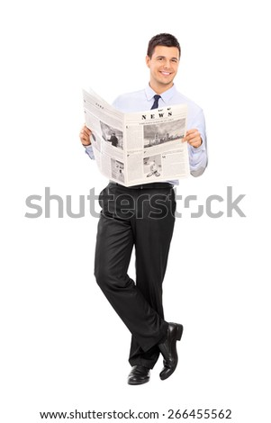 Handsome man holding a newspaper and leaning against a wall The newspaper is custom made, the text is Latin and the pictures are my copyright. You can find Model Releases attached.  - stock photo