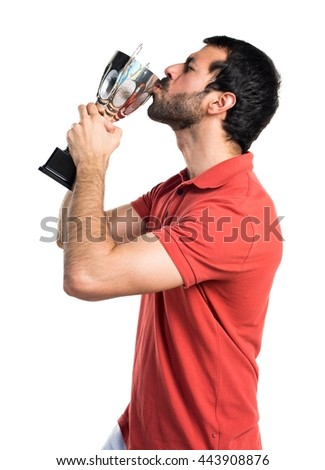 Handsome man holding a trophy