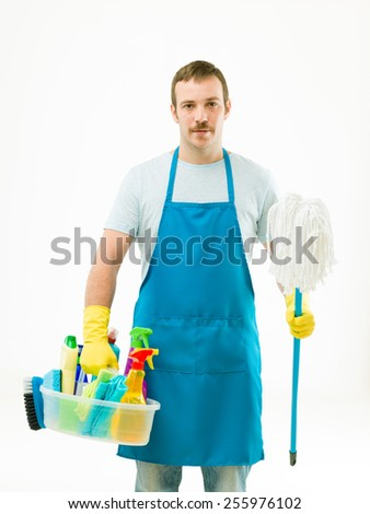 handsome man holding cleaning supplies and mop, on white background - stock photo