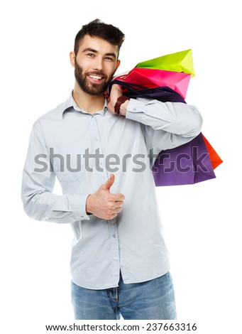 Handsome man holding shopping bags. Christmas and holidays concept - stock photo