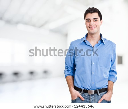 Handsome man in a bright room - stock photo