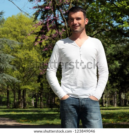 handsome man in a park in spring - stock photo