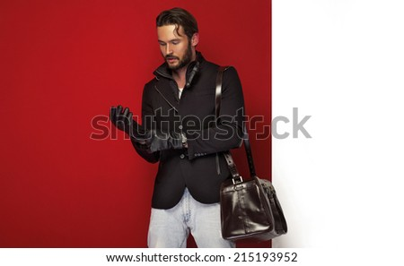 Handsome man in autumn clothes - stock photo