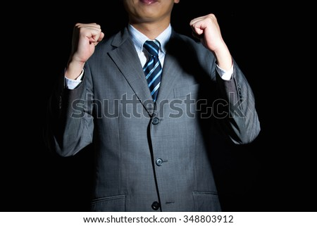 Handsome man in business suit is happy with success - stock photo