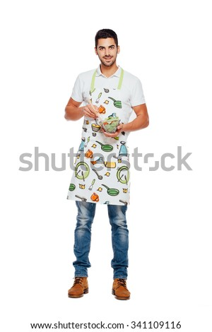 handsome man in kitchen apron and bowl of salad isolated on white - stock photo