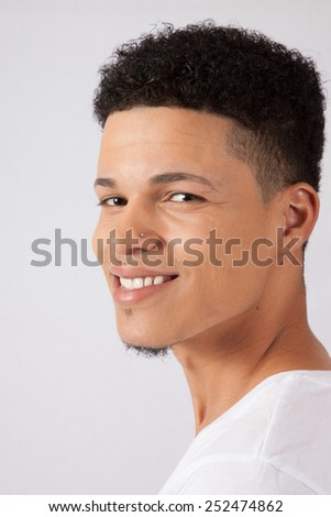 Handsome man in t-shirt, looking pleased - stock photo