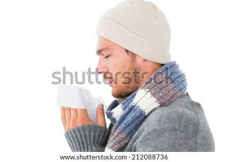 Handsome man in winter fashion blowing his nose on white background - stock photo