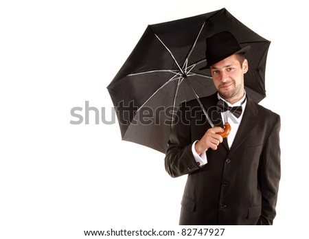 Handsome man is smiling with hat and umbrella - stock photo