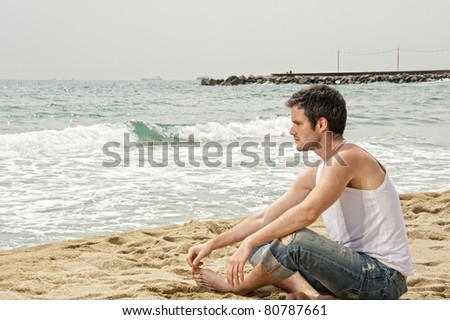 Handsome man looking at a sea - stock photo