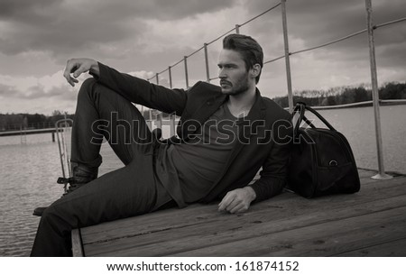 Handsome man lying and resting - stock photo