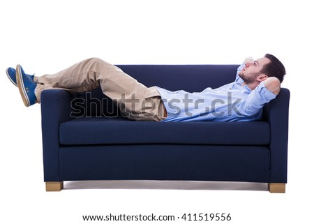 handsome man lying on sofa isolated on white background