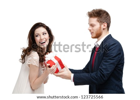 Handsome man makes present to his girlfriend, isolated on white - stock photo