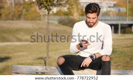 Handsome man making phone call outdoor in urban environment on with cell phone
