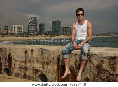 Handsome man near the sea - stock photo