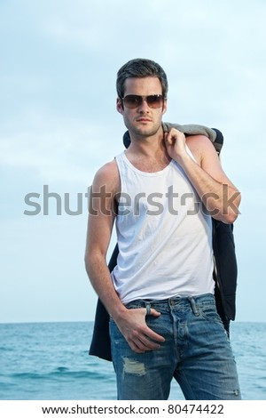 Handsome man on the beach - stock photo