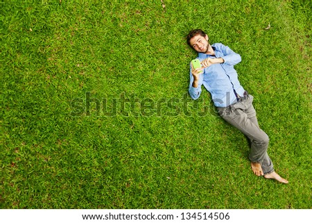 handsome man on the grass - stock photo