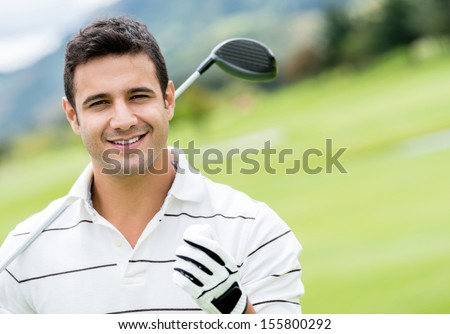 Handsome man playing golf and looking happy