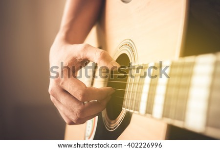 Handsome man playing guitar , close up - stock photo