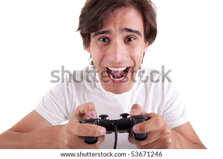 Handsome man, playing with game pad, isolated on white background. Studio shot - stock photo