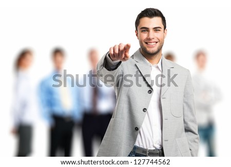 Handsome man pointing his finger to you - stock photo