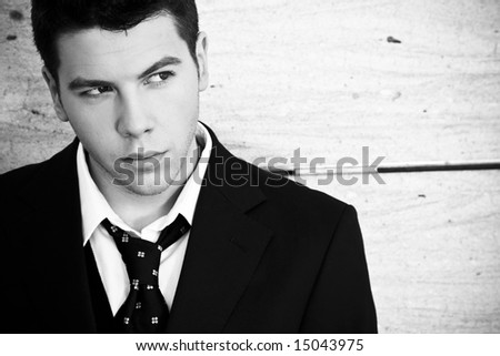 Handsome man portrait looking right on wall. - stock photo