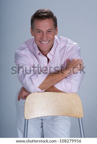 Handsome Man Posing For high key Studio Portrait