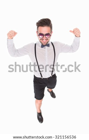 Handsome man posing in full length and showing his fists. Man in sunglasses demonstrating his strong and courageous attitude to everybody. - stock photo