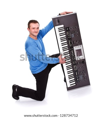 Handsome man posing with electric piano over white background - stock photo