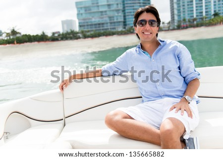 Handsome man relaxing on a yacht enjoying the summer - stock photo