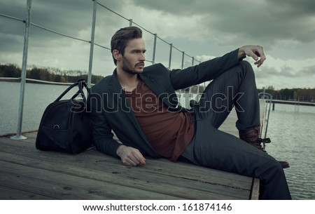 Handsome man resting - stock photo