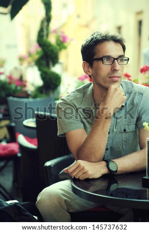 Handsome man resting at the cafe - stock photo