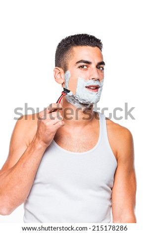 handsome man shaving his beard with a razor, on white background