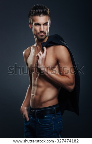 Handsome man shirtless posing in the studio - stock photo