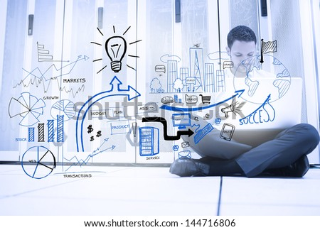 Handsome man sitting next to different sketches with icons - stock photo