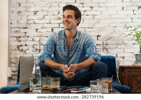 Handsome Man Smile Sitting at Cafe Table Looking Side Dream - stock photo