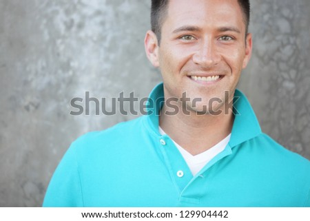 Handsome man smiling - stock photo