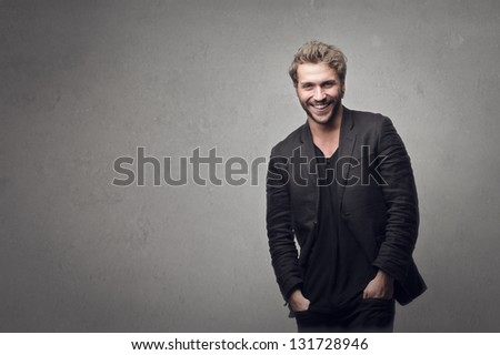 handsome man smiling on gray background - stock photo
